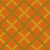 Knitted diamond shape seamless pattern in green and orange, vector Royalty Free Stock Photography