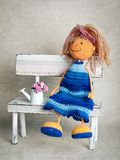 Knitted doll in blue dress Royalty Free Stock Images
