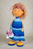 Knitted doll in blue dress Stock Images