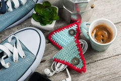 Knitted ear pods holder on wooden table Stock Photo