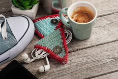 Knitted earpods holder on wooden table Stock Image