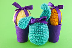 Knitted eggs and a rabbit Royalty Free Stock Photos