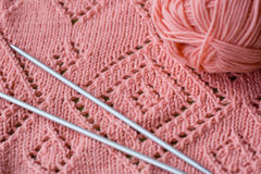 Knitted element  skein of yarn and knitting needles Royalty Free Stock Photo