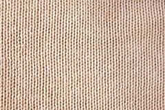 Knitted fabric. Macro of a woolen texture royalty free stock image