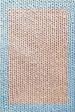 Knitted fabric. Macro of a woolen texture royalty free stock photos