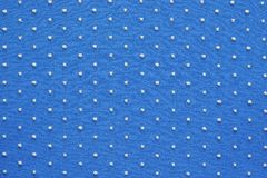 Knitted fabric of blue color with fluffy blond specks Royalty Free Stock Photos