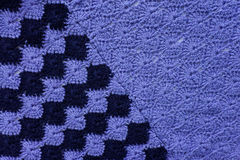 Knitted fabric of blue and dark blue yarn Royalty Free Stock Images
