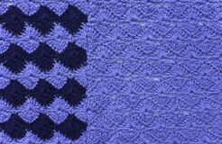 Knitted fabric of blue and dark blue yarn Stock Image