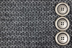 Knitted Fabric and buttons Stock Image