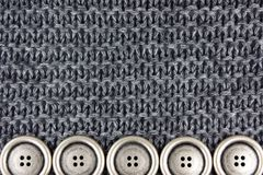 Knitted fabric and buttons Stock Photography