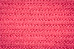 Knitted fabric - macro of a pink. Woolen texture Royalty Free Stock Image
