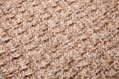 Knitted fabric - macro of a woolen texture Stock Photos