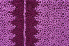 Knitted fabric made of pink yarn with dark inset Stock Photos