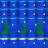 Knitted fabric in the New Year with style firs. Vector image of a knitted fabric in the New Year with style firs and white snowflakes on a blue background Stock Images