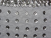 Knitted fabric with sequins Stock Photo