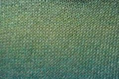 Knitted fabric in shades of green. From above stock photos