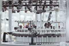 Knitted fabric. Textile factory in spinning production line and a rotating machinery and equipment production company.  royalty free stock images