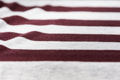 Knitted fabric texture and background with stripes Stock Images
