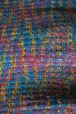 Knitted fabric texture. Closeup view of multicolored fabric jersey. Multicolor abstract background and texture for designers. Colo Stock Images
