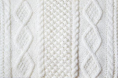 Knitted fabric texture. White knitted fabric texture backgrond stock photo
