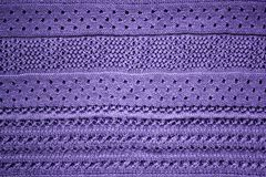 Knitted fabric violet background close up stock photography