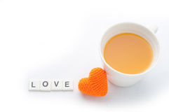 Knitted fabrics heart shape, love message and orange juice isolated on white background. Valentine day greeting card stock photos