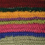 Knitted fine wool garment colorful stripes background natural texture, yellow, beige, claret, pink, blue green scarf macro closeup Stock Image