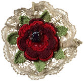 Knitted flower brooch Stock Image