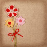 Knitted flowers postcard Royalty Free Stock Photo