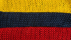 Knitted fragments of the flag colors: red, blue, yellow Stock Photography