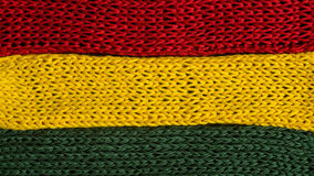 Knitted fragments of the flag colors: red, green, yellow Royalty Free Stock Photo