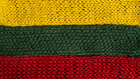 Knitted fragments of the flag colors: red, green, yellow Royalty Free Stock Image