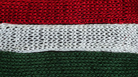 Knitted fragments of the flag colors: red, white, green Royalty Free Stock Image