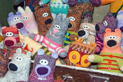 Knitted fun pets. The stockpile of colorful knitted fun pets Stock Photos