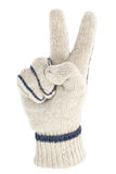 Knitted glove with victory or peace sign Stock Image