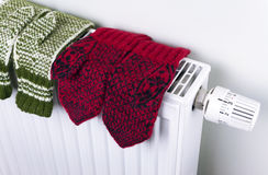Knitted gloves drying Stock Photography