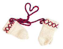 Knitted gloves Lovikka, traditional handicraft from Sweden isolated on white. Traditional handicraft from Sweden isolated on white from above with heart shaped Royalty Free Stock Image