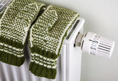 Knitted gloves on the radiator Stock Photo