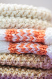 Knitted gloves stacked Stock Image