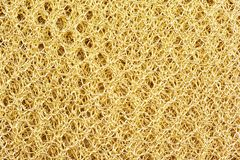 Knitted golden texture royalty free stock photo