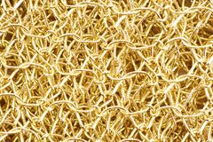 Knitted golden texture Stock Image