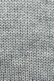 Knitted gray background Royalty Free Stock Photo
