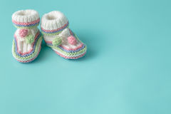 Knitted green baby booties for little boy Stock Image