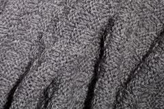 Knitted grey scarf Royalty Free Stock Images