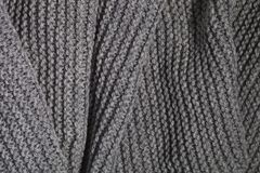 Knitted grey scarf. Closeup macro image stock photo