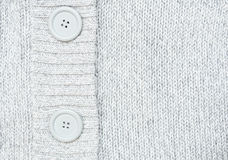 Knitted grey sweater with buttons  Knitted woole Royalty Free Stock Photography