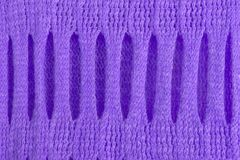 Knitted woolen texture with beautiful holey tracery of ultra violet for abstract pattern backgrounds. stock photos