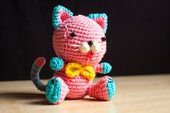 Knitted handmade cat toy. On the table Royalty Free Stock Photography