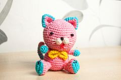 Knitted handmade cat toy. On the table Stock Photo