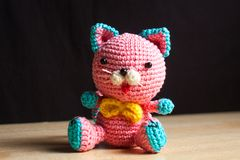 Knitted handmade cat toy. On the table Royalty Free Stock Photo